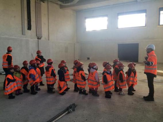 Kids getting a tour of a tech factory recreates Minions