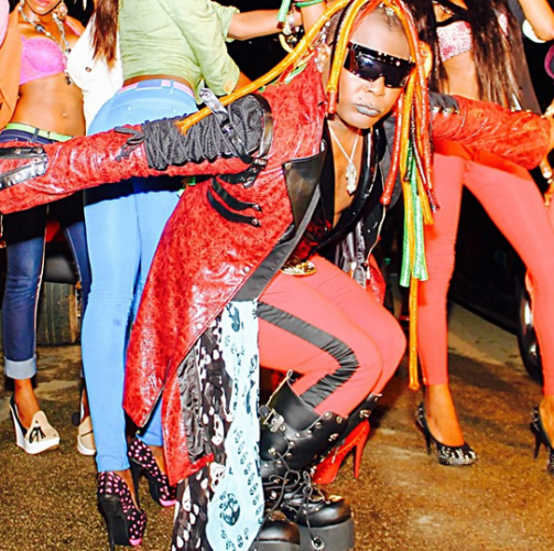 Charly boy dancing in colourful photo