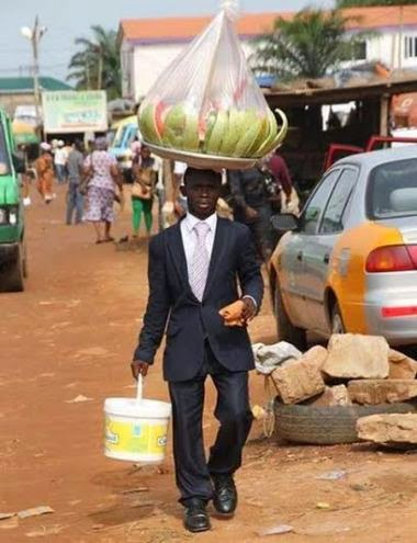Funny: Ghanaian man on suit sells Watermelon