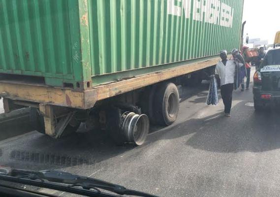 Truck running on burst wheel in Lagos