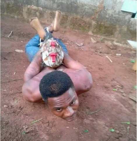 Fake Pastor Caught While Trying to Bury a Pot of Charms Inside a Compound in Anambra State (Photos)