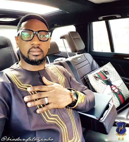 Out-roar on Twitter and IG as COZA Pastor poses with a N1m+ Gucci bag
