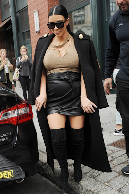 Kim Kardashian confesses to using long garments to 'cover her fat arms and ass'