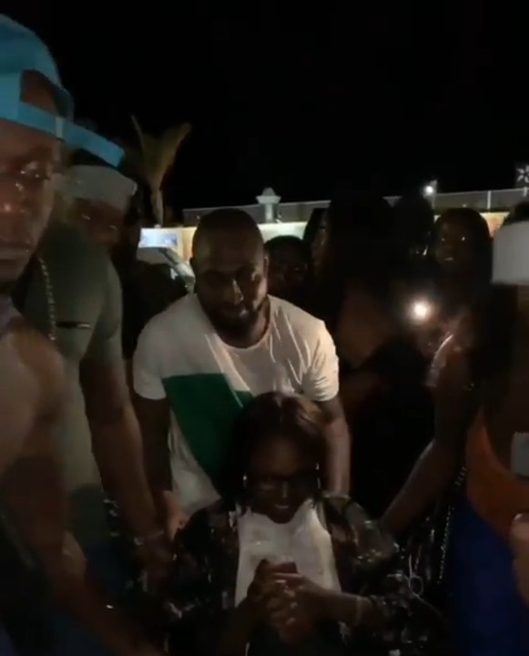Davido Humbly Pushing Physically Challenged Woman On a Wheelchair