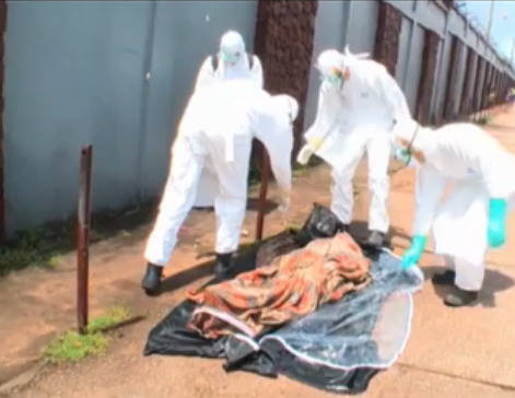 Photo: See incredible moment funeral workers realise 'dead' Ebola victim is alive